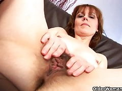 Mature mom spreads her hairy pussy