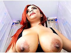 Redhead MILF giving amenable solo