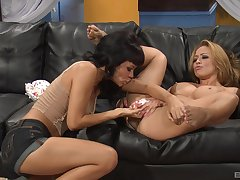 Lesbian milfs Ruby Knox and Mia Lelani having sex on the couch