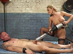 Cherie DeVille straps a dildo gag on the top of him and uses his exposure to get off