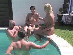 Mature amateurs fucked wide of the pool wide of their mature husbands