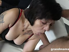 Two sex-starved guys fuck mouth and pussy of harpy granny in red stockings