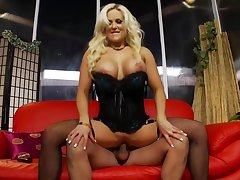 Busty blonde milf in black fishnets is possessions fucked from the back and loving it