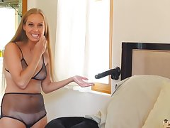 Kinuski is a super horny blonde who likes to play with a big, black dildo