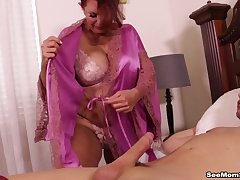 Milf Andi James sucks of a hung stud in the bedroom.