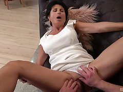 Dirty mature Petra spreads her legs to be fucked by a younger sponger