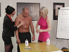 Clothed office bodies are intrigued about this man's capabilities