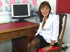 Georgie strips and fingers her hairy pussy in advance office