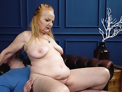 Red-haired granny sucks phallus plus gets screwed hard