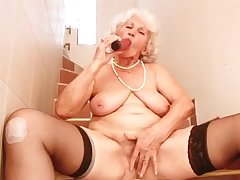 Laughing mature whore with saggy big tits Betty pets her bedraggled slit