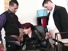 Mature office trollop enjoys two cocks
