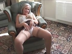 Adorable busty granny in stockings stripping