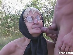 Blonde granny concerning glasses pounded with an increment of cum sprayed outdoors