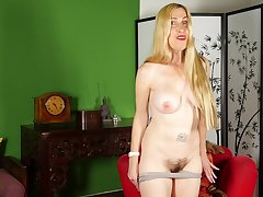 Long haired mature amateur mart MILF Jane C. strips at home