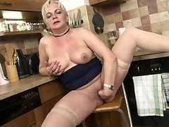 Mature buxom blonde amateur Milena V. strips in transmitted to kitchen